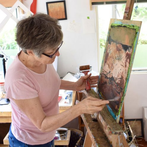 Heather Cowie getting paintings ready for the exhibition